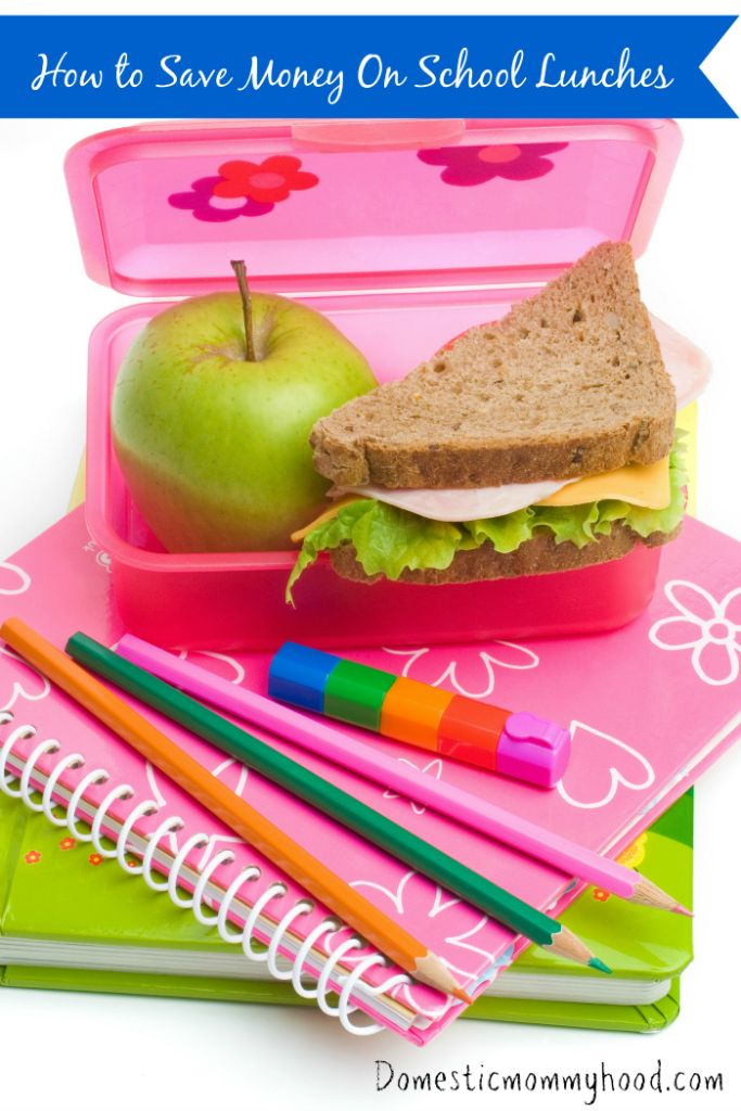 books, color pens and lunch box with sandwich